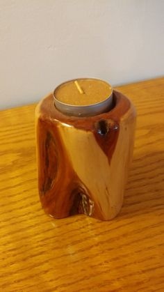 A beautiful wood / glazed tea light candle holder Made in New Hampshire Measures: 4 inches in height x 2.75 inches in diameter Comes with a tea light