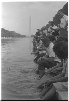 [Demonstrators sit, with their feet in the Reflecting Pool, during the March on Washington, 1963]