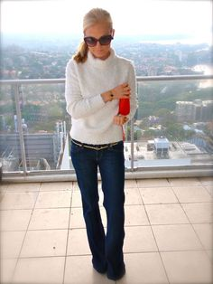 Jeans, gold blet, white top, red purse, sunglasses = CLASSIC.