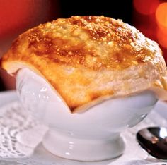 Lobster bisque covered with puff pastry and baked in oven.