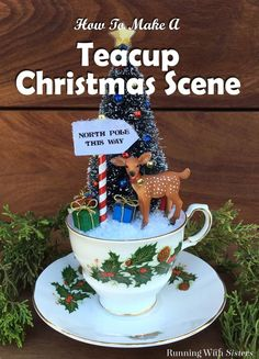 DIY Teacup Christmas Scene - make a snowy Christmas scene in a vintage style teacup and saucer! This craft how to explains step by step how to create a base in the teacup, how to paint wooden cubes as wrapped presents, how to make the candy cane striped North Pole This Way sign, how to decorate the bottle brush tree, and how to put it all together to create the snowy scene! Includes a printable download for the sign! Such a cute craft project for the holidays!