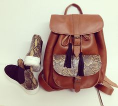 handmade leather back pack and sneakers. Feel the love by Rena Xenou