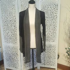 Black and Grey Cardigan Black and grey long sleeved cardigan with grey around the neck and down the front edge. Kinda makes it look like you are wearing a cute scarf. Grey from the elbow to wrist also. Thin material. Sweaters Cardigans