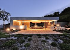 South African studio Metropolis has completed a concrete pavilion in the grounds of a house in Cape Town