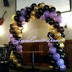 Gold black and purple balloon arch