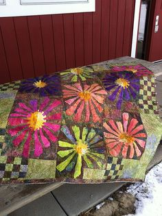 Batik flowers.  Fun quilt, looks like the appliqué is  fused - looks fun!