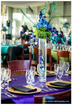 Bride Johanna's love of peacock feathers was incorporated into her centerpieces. Decor by Lucy Celebration. Photo by Alex and David