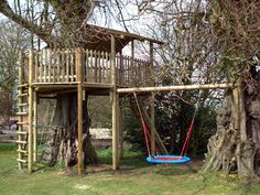 Simple tree house with a swing (or two). I love that there's multiple ways to get up and down.