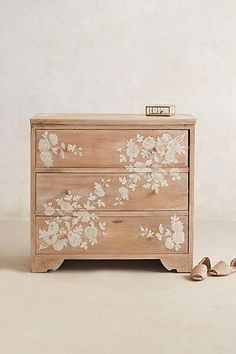 Anthropologie EU Pearl Inlay Dresser. Employing a centuries-old decorative technique, this handcarved, three-drawer dresser is inlaid with luxurious mother of pearl that lends it texture and contrast. Ornamented in neutral white, it's simply striking in both classic and contemporary bedrooms.