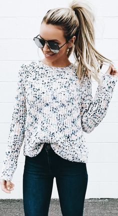 Cute warm weather fashion long sleeve white top ponytail style