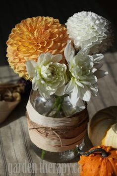 thanksgiving flowers in a corn-husk-wrapped mason jar.
