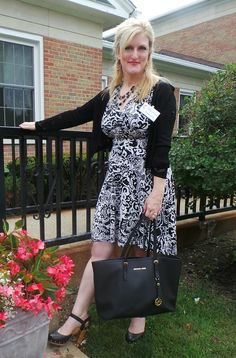 Frockstar™ Shelley styles her Karina Dress with a sweater, handbag and coordinating mules http://www.karinadresses.com/frontpage