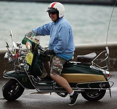 A scooter is driven along the sea front during the the Isle of Wight International Scooter Rally