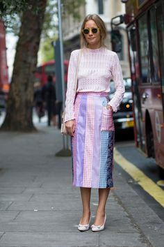 On the street at London Fashion Week. =