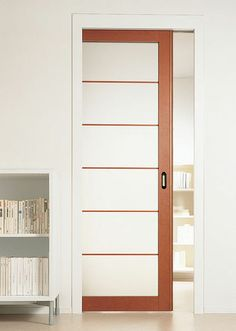 Sliding door for master bedroom toilet.  Glass and wooden pocket door FLUO by Movi. The ideal solution to maximize space. This system permits the door to slide into the wall and disappear, saving space. Matching hinged door available