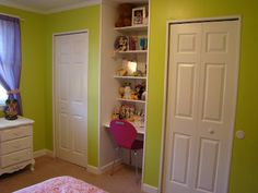 Closets with a built-in desk between them . Great use of space for a small room!