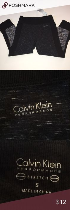 NWT Calvin Klein leggings Calvin Klein black and grey cropped workout leggings. Brand new with tag, perfect condition. Size Small (Non smoking household) Calvin Klein Pants Leggings