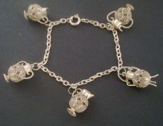 A beautiful original vintage charm bracelet. Hallmarked for silver. Pretty intricate filigree pots and urn charms. One of the urns has a cute