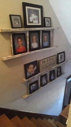 Ladder picture display in staircase.