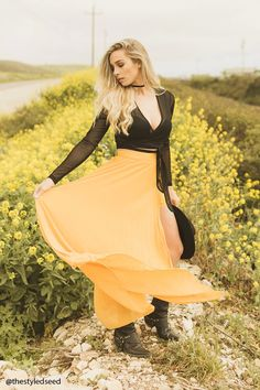 A woven maxi skirt featuring an accordion pleated design, concealed side zipper, a shorts underlay, and side slit detail.