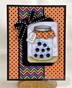 "You can ""see"" how cute this Love Bugs mason jar is when it's filled with googly eyes! Brightly colored papers and a black and white ribbon tie up this handmade Halloween card."