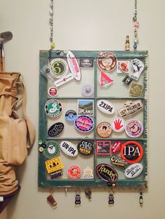 Repurposed an old window. Added a chain for hanging and hooks for additional display. Then added my husbands collection of beer stickers pins and key chains Fun Crafts, Diy And Crafts, Arts And Crafts, Travel Sticker, Travel Wall, El Canton, Pop Stickers, Ideias Diy, Displaying Collections