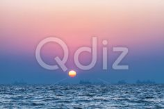 Qdiz Stock Photos | Sunset over sea,  #arabian #awe #backdrop #background #beautiful #color #dusk #environment #evening #eventide #flowing #glow #heat #horizon #idyllic #leisure #ocean #reflection #romance #romantic #scene #sea #seascape #serenity #sky #space #summer #Sun #sunlight #Sunset #sunshine #surf #surface #tide #tranquil #Travel #twilight #vacation #view #water #wave #yellow
