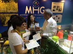 CSO, Dr. Isao Noda assists potential investors in their booth at CIFIT