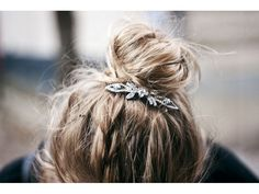 Add some bling to your knot with an adorable hair pin.        Credit: Beauty High (Courtesy: HonestlyWTF) - via StyleList