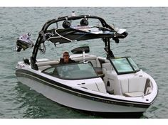 2011 Correct Craft Nautique 230 Super -All fluids and rubber changed every 50 hours. Perfect condition. Top of the line Black Trailer with 2x axles and 4x disc brakes. - See more at: http://www.caboats.com/used-boats/8826.htm