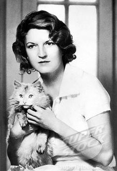 Zelda Fitzgerald and her not-only-married-to-a-famous-writer-but-a-writer-on-her-own-right kitty.
