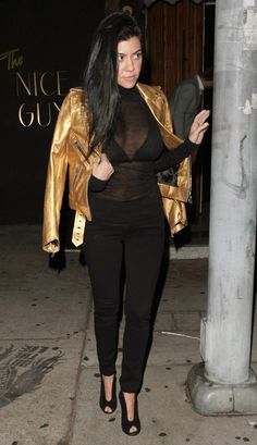 Taking a cue from sister Kim Kardashian, Kourtney Kardashian steps out in a sheer top for a girls' night.
