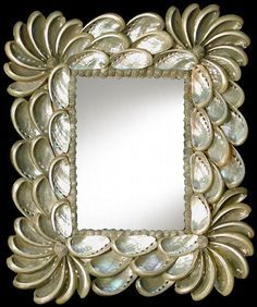 This is a shell mirror with a frame made of Haliote Shells. The frame measures 9 by 11. The shells give a beautiful shiny appearance.  The mirror