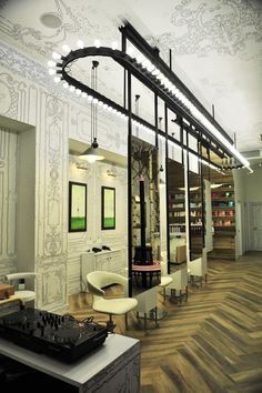 """Location,Moscow,Russia . Each element in the interior (handmade wall-paper, manicure (nail) table, armchair """"Sofi Sofa"""", exclusive bar design in waiting room, wood wall shelves, mirror construction with 138 bulbs and also painting expositions) is individual. Beauty salon """" Sakurami"""" is art module space."""