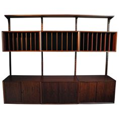 Rosewood Wall Unit by Poul Cadovious for Cado | From a unique collection of antique and modern shelves and wall cabinets at http://www.1stdibs.com/furniture/wall-decorations/shelves-wall-cabinets/