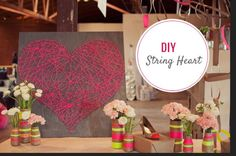 DIY its easy get a board and nail,nails in a heart shape and rap string in all directions !!!!