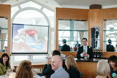 Best man's speech using a projector at the Sandbanks Hotel. Documentary wedding photography in Dorset.