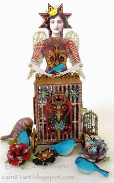 By Linda Cain using the 3-D Bird Cage Doll Shrine Kit, Bird Cut Outs, Window Scroll Cut Outs, Doll Head Paper Cuts, and more from Retro Café Art Gallery. www.RetroCafeArt.com