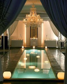 indoor pool with neoclassic decor and chandelier