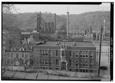 Monessen Works, Westmoreland Co,, PA VIEW FROM PARK DRIVE LOOKING WEST, SHOWING WHEELING PITTSBURGH BLAST FURNACES WITH PAROCHIAL SCHOOL (ST. LEONARDS) IN FOREGROUND. - Pittsburgh Steel Company, Monessen Works, Donner Avenue, Monessen, Westmoreland County, PA