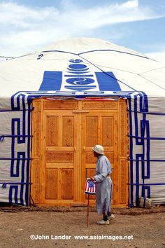 Mongolian Woman with a Shopping Bag. That ger door is about 3 times again as big as the one on our camping ger!