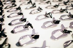 Escort Cards = Favors ... Airplane luggage tags. Photography by elizabethandrich.com