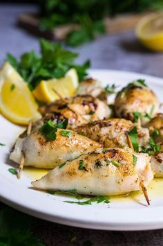 Stuffed calamari in lemon butter sauce - these delicious calamari bites are stuffed with creamy tuna filling, then cooked in a luscious tangy lemon butter sauce, with capers, garlic and lots of fresh parsley.