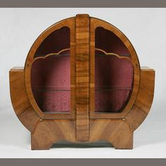 British, circa 1940, an Art Deco Walnut display cabinet
