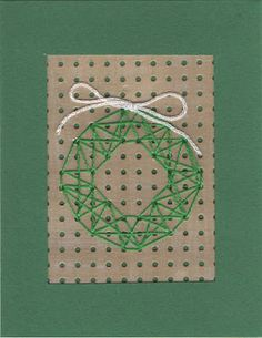 Stitched Wreath Christmas card by welaughindoors
