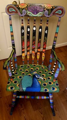 DIY Chair & Furniture Art! Look at what a little paint and fabric can do to and old chair! This Peacock Chair could retail up to $800 if you saw it in a store. | follow rickysturn/diy-home-decor