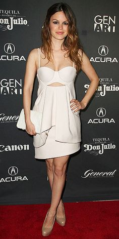 Rachel Bilson in a white peekaboo corset dress by Preen paired with nude Brian Atwood pumps and a matching Cecelia clutch.
