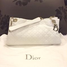 For Sale: Lady Dior Tote: white. Lady Dior Tote: Price can be negotiated. Original price is $1830 (tax included)(I still have the Authentication card and price tag).Only worn 3 times. Come with dust bag. Slight crease/wrinkle near the Dior chains. Both sides on the inside has compartments and a zipper compartment in the middle. A picture comparison to show the size of this purse compared to a never full MM. Overall really good condition! I'm selling because being a new mom, this doesn't suit…