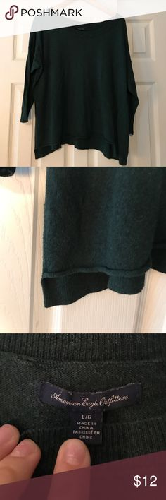 Dark Green American Eagle Sweater Dark Green American Eagle Sweater, size L, one small hole in front as pictured. American Eagle Outfitters Tops