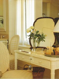 Jeffrey Bilhuber designed this bathroom & dressing room for a weekend home in PA. The owners weer quite adamant about having no color in the room - so Bilhuber used more than a dozen shades of white to give the room depth and form. This 19th-century bamboo chest was re-painted and used as a dressing table.  Photo (C) John Vaughan from my book 'Bathrooms'